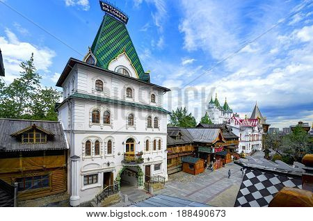 MOSCOW, MAY 26, 2017: Izmailovsky Kremlin inner yard. White stone manor. Russian traditional classic wooden and stone architecture buildings. Classic white stone empirial palace Russian architecture