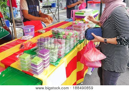 Muslim Shoppers Buying Food From Street Vendor For Breaking Fast Or Iftar