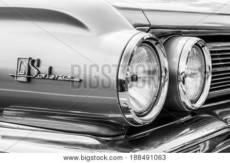 BERLIN GERMANY - MAY 17 2014: Detail of the full-size car Buick LeSabre 4-Door Sedan (1962). Black and white. 27th Oldtimer Day Berlin - Brandenburg