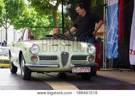 BERLIN GERMANY - MAY 17 2014: Leading exhibition takes interview driver Italian car Alfa Romeo Giulietta Spider. 27th Oldtimer Day Berlin - Brandenburg
