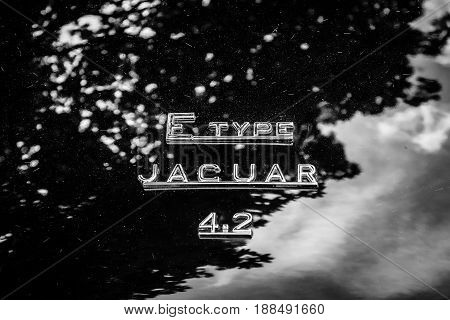 BERLIN GERMANY - MAY 17 2014: The emblem on the trunk of the sports car Jaguar E-Type 4.2. Black and white. 27th Oldtimer Day Berlin - Brandenburg