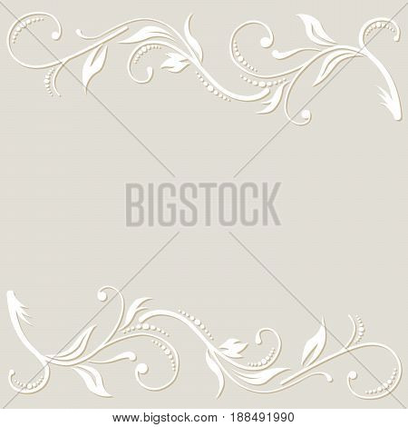 The white floral ornament on the light cream background. Cut from a papper.