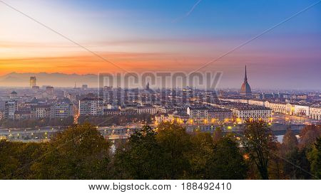 Cityscape Of Torino (turin, Italy) At Dusk With Colorful Moody Sky. The Mole Antonelliana Towering O