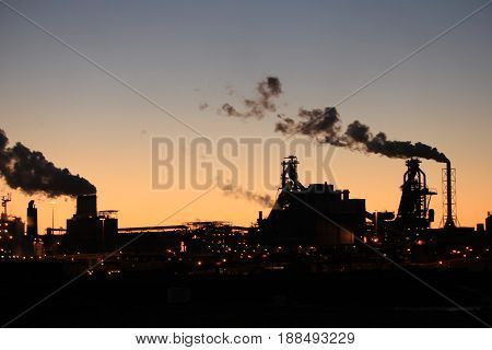 Skyline of an industrial area during sunset