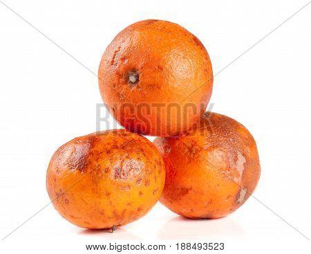 three damaged tangerine isolated on white background.