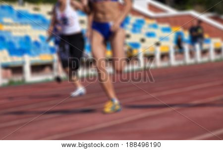Blurred View Of Athletic Running Competition At Stadium Not In Focus