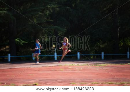 Blurred View Of Woman Athletic Running Competition At Stadium