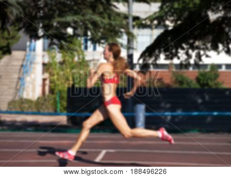 Blurred View Of Running Girl At Stadium Not In Focus