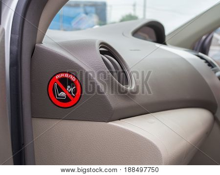 red caution sign for safety child air bag in car. concept of protected accident in car.