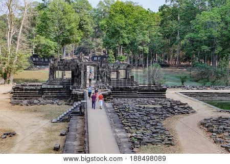 Siem Reap, Cambodia - February 2, 2016: Unidentified tourists visit to Baphuon Temple in Angkor Complex, Siem Reap, Cambodia. Ancient Khmer architecture and famous Cambodian landmark, World Heritage