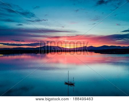 Aerial of an amazing sunset with sailing vessel at Loch Creran, Barcaldine, Argyll, Scotland