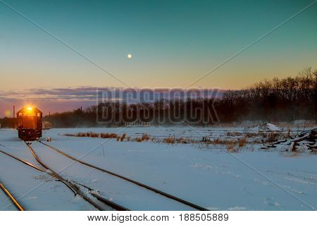 Freight Train Travels Through The Vast Expanses Of Snow-covered