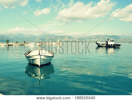 Small fishing boats. A calm, tranquil and peaceful marina in Greece.