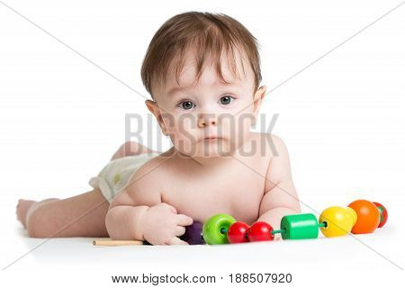 Portrait of cute baby boy with developmental wooden toys. Isolated on white background.