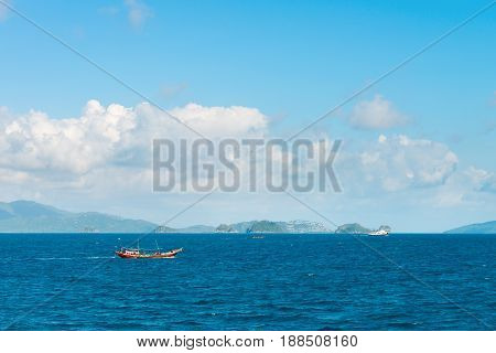 Tropical Sea Landscape With Boat Sailing