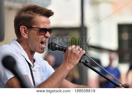 VILNIUS LITHUANIA - MAY 20: Unidentified musician sings in Street Music Day on May 20 2017 in Vilnius. Its a most popular event on May in Vilnius Lithuania