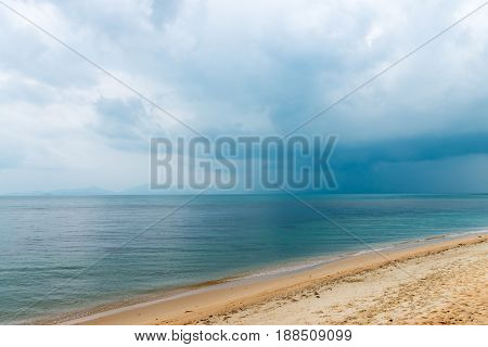Dark Clouds And Tropical Rain Over The Sea