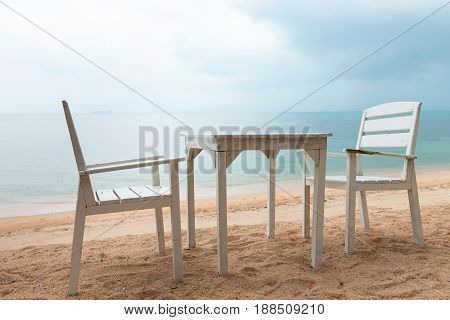 Romantic Cafe With White Table And Chairs On The Sea Shore