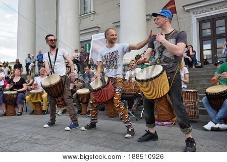 VILNIUS LITHUANIA - MAY 20: Unidentified musicians play drums and other instrument in Street Music Day on May 20 2017 in Vilnius. Its a most popular event on May in Vilnius Lithuania