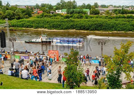 Tyumen Russia - July 31 2016: Celebration of City Day. Embankment with festive actions and the walking people