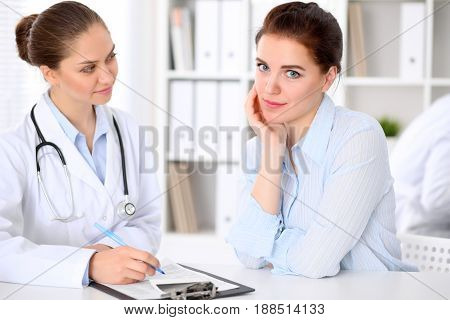 Doctor and patient sitting at the table. Very bad news concept