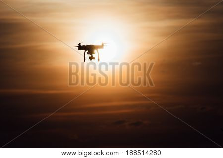 A drone fly over sunset with warm color in siloutte scene