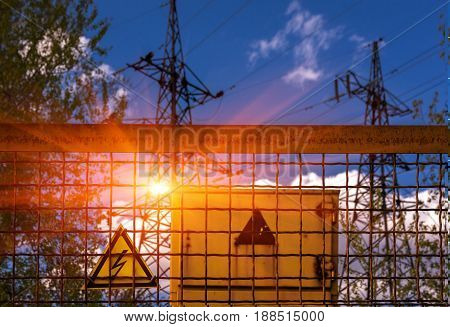 Sign dangerously high voltage on the background of high-voltage lines