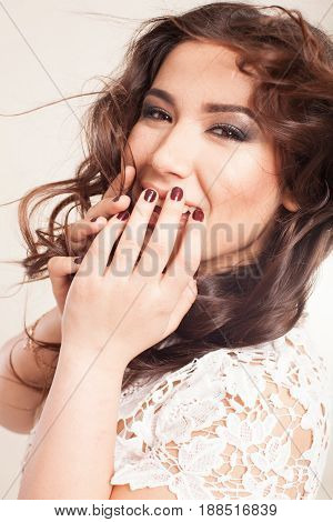 beautiful girl posing in the Studio emotion laughter curls hairstyle