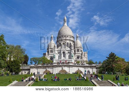 Paris, France - May 12, 2017: Front view of the famous basilica Sacre coeur in Montmartre district with people in front
