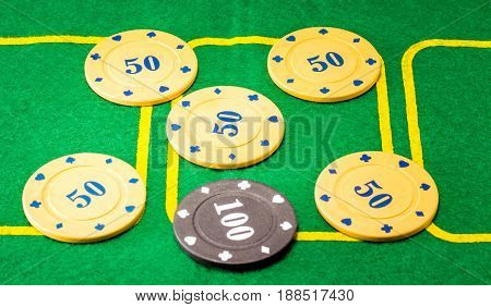 Background of six plastic chips for poker one is different one it is more expensive and meaningful than the rest