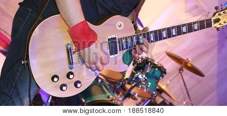 Guitarist Plays Electric Guitar On Stage During A Live Concert