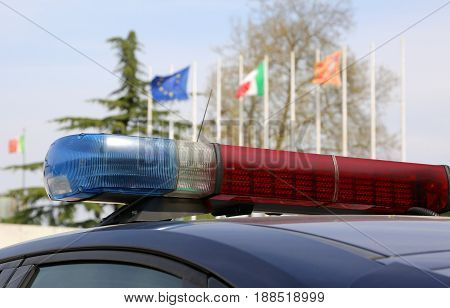 Sirens Of A Police Car With European And Italian Flags On Backgr