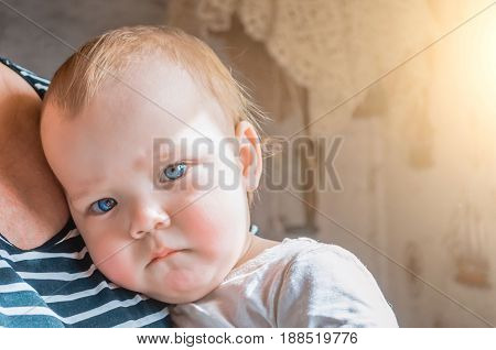 Thoughtful Glance Of The Child Pressed To His Grandmother's Breast.