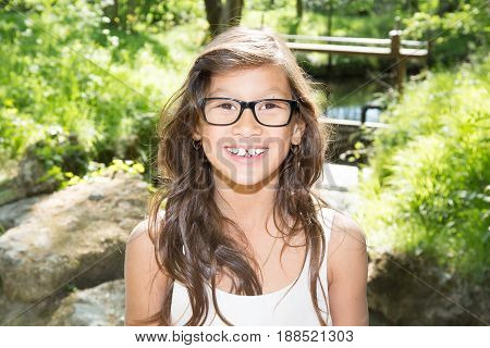 Ten Year Old Girl With Long Hair Outdoor Park