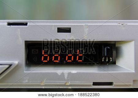 Macro front shot of an abstract electronic device with boot message on screen