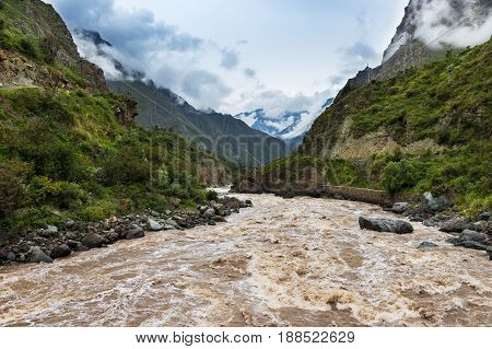 Crossing the Urubamba River in the beginning of the Inca Trail in the Sacred Valley Peru