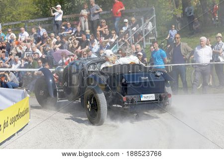 STOCKHOLM SWEDEN - MAY 22 2017: Rear view of a dark blue Bentley classic car from 1923 in the public race Gardesloppet at Djurgarden Stockholm Sweden. May 22 2017