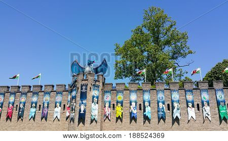 Cardiff Wales - May 26 2017: Cardiff Castle decorated with a dragon the blue beast accompanied by a giant trophy and photographs of players on the wall ahead of the Champions League Final at the Wales Millennium Stadium.