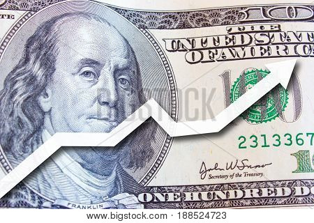 Money 100 dollar bill close-up Photo background. The growth of the dollar and the white up arrow