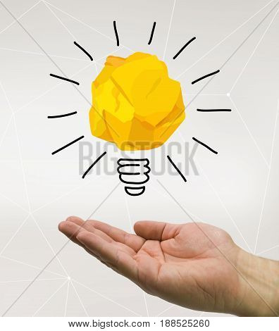 hand holding an idea paper bulb, in tech backgound