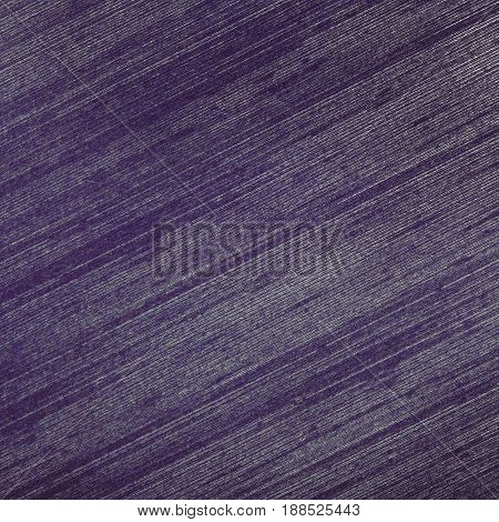 Metal surface with a purple tinge. Walpaper background
