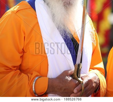 Sikh Man With Sword And Long White Beard