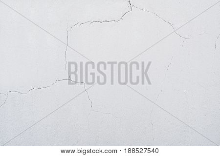 On The Wall A Lot Cracks On A Beige Plaster