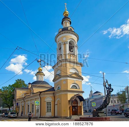 Moscow Russia - May 18 2017: Church of Nativity of the blessed virgin in Kulishki and monument to children of Beslan. Street Solyanka 5/2. Moscow