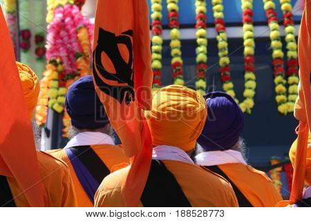 Sikh Religion Representatives With Flags And Dresses During The