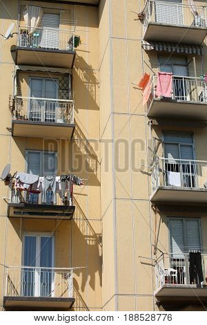 Skyscraper With Terraces And Hanging Clothes