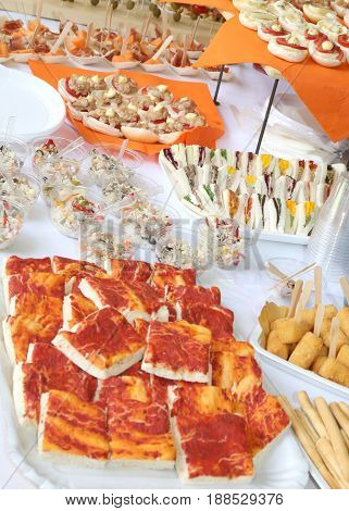 Tasty Sandwiches And Pizza On The Table Of Restaurant For Weddin