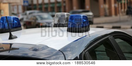 Blue Sirens Of Police Car During A Control Checkpoint In The Cit