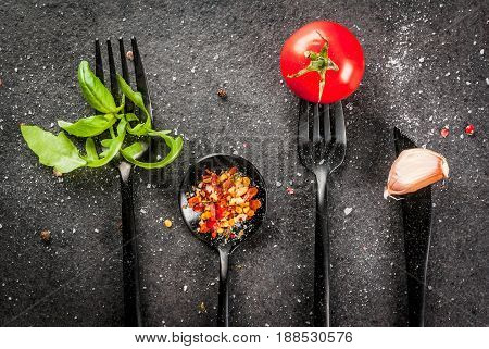 Cooking Background. A Set Of Black Tableware Items - Forks, Knife And Spoons With Fresh Herbs (basil