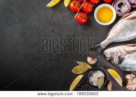 Fresh Raw Organic Fish Dorado, Sea Bream With Ingredients For Cooking Lemon, Tomatoes, Onion, Salt,
